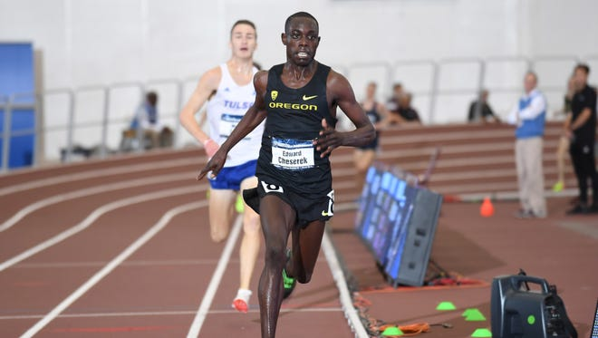 Mar 10, 2017; College Station, TX, USA; Edward Cheserek of Oregon wins the 5,000m in 13:41.20 during the NCAA Indoor Track and Field Championships at the Rhonda and Frosty Gilliam Jr. Indoor Track Stadium at the McFerrin Athletic Center. Mandatory Credit: Kirby Lee-USA TODAY Sports