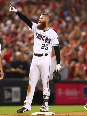 Arizona Diamondbacks relief pitcher Archie Bradley celebrates after hitting a two run triple in the 2017 National League wildcard playoff baseball game against the Colorado Rockies at Chase Field.