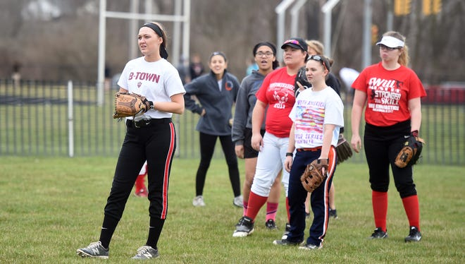 Richmond High School Softball players practice March 21 at the RHS softball diamond. Richmond school officials hope to make improvements to the softball facilities with public approval.