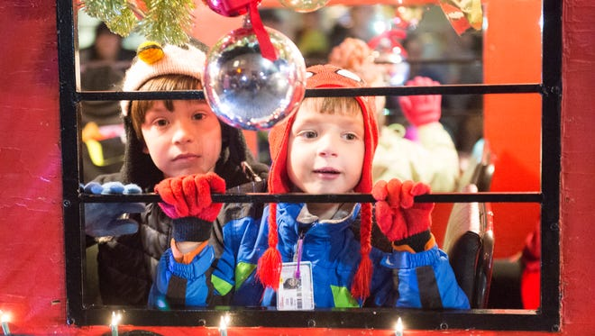 Youngsters ride on a float in Waynesboro's annual Christmas Parade on Saturday, Dec. 3, 2016.