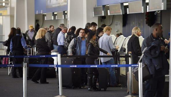 Travelers at Terminal C at Newark Liberty International