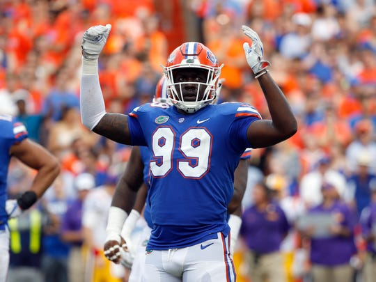 Oct 7, 2017; Gainesville, FL, USA;Florida Gators defensive lineman Jachai Polite (99) gets the fans pumped up against the LSU Tigers  during the first half at Ben Hill Griffin Stadium. Mandatory Credit: Kim Klement-USA TODAY Sports