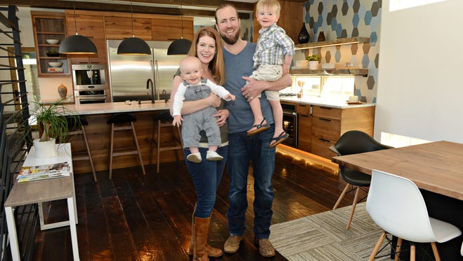 Rucker and Rebecca Hill pose for a portrait with their sons Levi, 7 mos., and Jude, 3, inside a modern home they designed and built on Mountain Avenue. The local couple moved their company, Rucker Design Build, from Texas a few years ago.