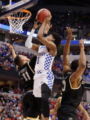 Kentucky Wildcats guard De'Aaron Fox (0) shoots against Wichita State Shockers guard Landry Shamet (11) during the second half in the second round of the 2017 NCAA Tournament at Bankers Life Fieldhouse.