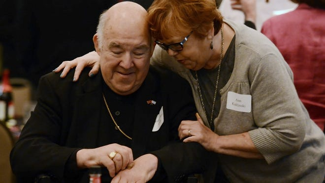 The Most Reverend David R. Choby, Bishop of Nashville, visits with Ann Kuklinski before a Community Relations Seder at the Gordon Jewish Community Center on Tuesday, April 12, 2016 in Nashville, Tenn.