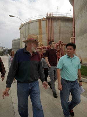 Wastewater Division Manager Thien Ng, right, talks with Mike Deckard, of Port Hueneme, as Ng leads members of the public in a tour of Oxnard's wastewater treatment plant in October. Members of the utility rate advisory panel are scheduled to take a similar tour on Jan. 26.