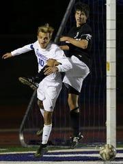 CC's Justin Savona (left) tries to receive the pass