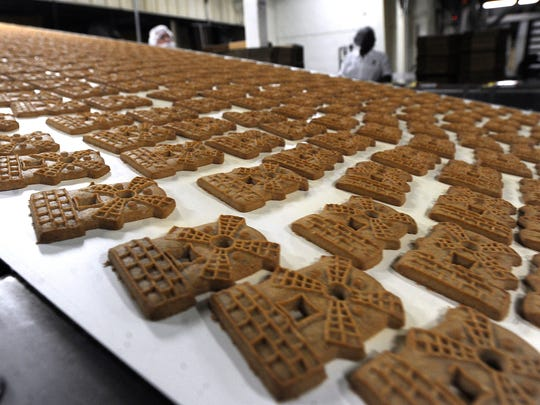 Thousands of almond windmill cookies move down a conveyor belt to be packaged at AbiMar's cookie plant on North 1st Street on Thursday, March 18, 2017.