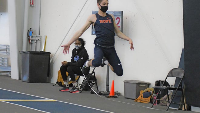 Hope College student-athlete Nathaniel Woolum competing in the long jump event on Saturday, Jan 16, 2021