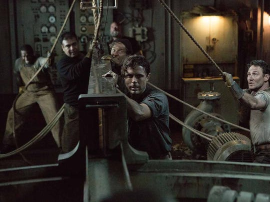 """Ray Sybert (Casey Affleck) and Tchuda Southerland (Josh Stewart) struggle to keep their ship, the SS Pendleton, from sinking in Disney's """"The Finest Hours."""""""