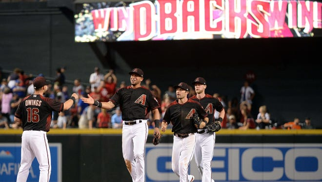 David Peralta  and A.J. Pollock, center, are healthy this year, and they are helping boost the Arizona Diamondbacks' fortunes.
