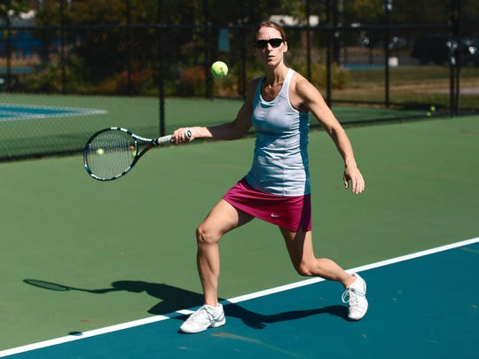 Marni Young plays tennis at Beachwood tennis and swim
