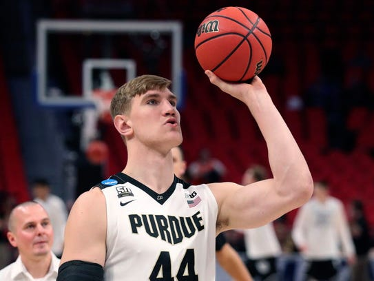 Purdue center Isaac Haas shoots during warm-ups before