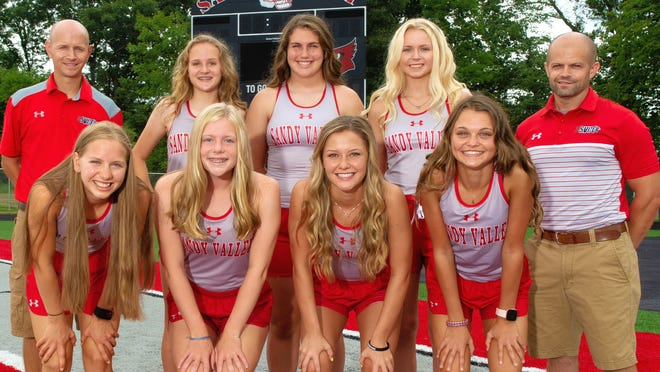 Members of the 2020 Sandy Valley girls cross country team are (front row, left to right) Deana Peterson, Krista Glaser, Christine Lawver and Kalia Sarver; and (back row) Head Coach Greg Howard, Kaydence Hoover, Alli Neary, Jenna Raderchak and Coach Jedediah Lee.