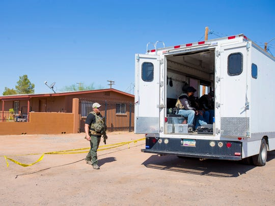 Law-enforcement officers investigate the deaths of four people in Casa Grande on Oct. 5, 2017.