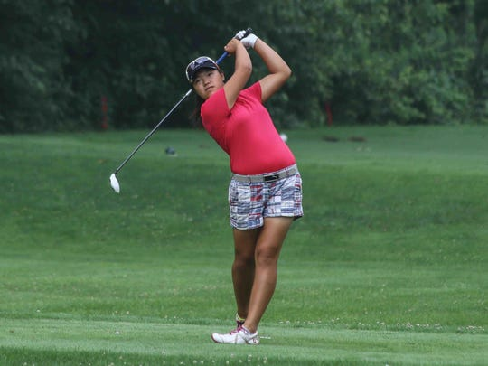 Esther Park tees off on the 11th hole during the Delaware Women's Golf Association Junior Girls tournament.