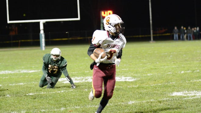 Gibson Southern junior Andrew Smith returns one of his two interceptions against Vincennes Lincoln during the Titans' 39-28 win last Friday.