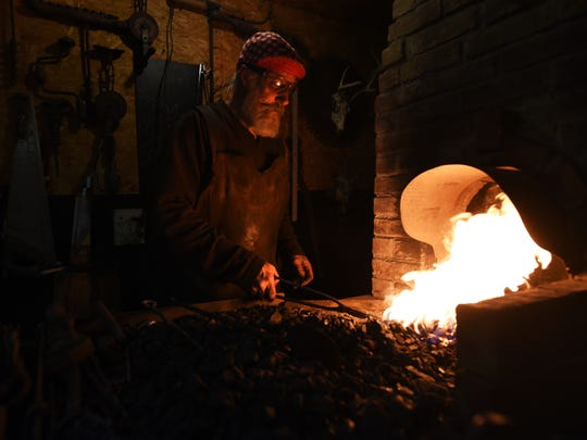 John Abrams works at his forge in Zanesville. Abrams