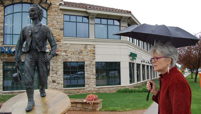 Fort Collins sculptor Shelley Kerr looks on as a crew readies to dismantle her statue of Antoine Janis. Kerr said she is redoing the statue's head to make it more anatomically correct.