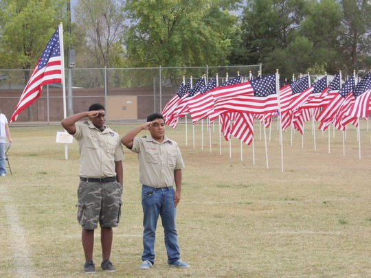 Boy Scouts from Mesquite Troop 2060 salute during the 1,000 Flags OVer Mesquite closing ceremony Sunday.