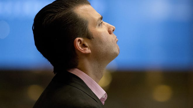 FILE - In this Nov. 15, 2016 file photo, Donald Trump Jr., son of President-elect Donald Trump waits for an elevator at Trump Tower in New York. Donald Trump Jr. told the Senate Judiciary Committee that he couldn't remember whether he had discussed the Russia investigation with his father, according to transcripts released Wednesday of his interview with the panel. (AP Photo/Carolyn Kaster)