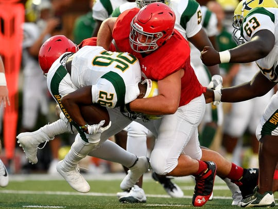 Brentwood Academy's Airin Spell (58) takes down Hillsboro's