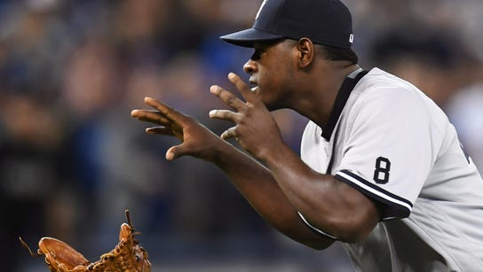 New York Yankees pitcher Luis Severino throws away