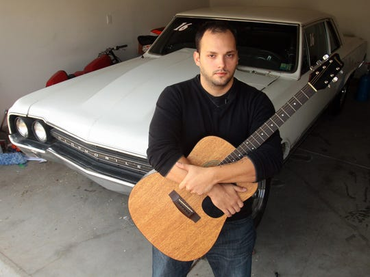 Marine veteran Steven Afalla holds a guitar that belonged to one of his closest friends, Marine Cpl. Donald D. Fowler. Afalla survived a high-speed crash that killed Fowler on Feb. 7, 2011, along Highway 62 east of Twentynine Palms.