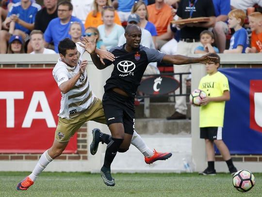 FC Cincinnati defender Justin Hoyte (32) dribbles the
