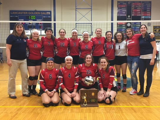 Members of the Fairfield Christian Academy volleyball team pose after winning the Division IV regional championship. The Knights will play in the state tournament at 6 p.m. Thursday at Wright State University.