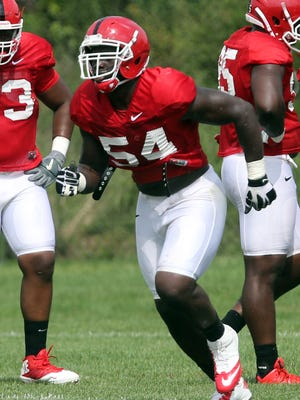 Rutgers right tackle Kamaal Seymour practicing on defense during training camp