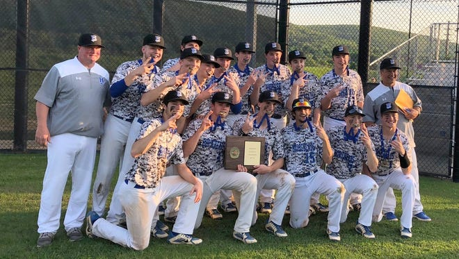 Horseheads poses with its championship plaque after sweeping Corning in the Section 4 Class AA championship series May 23 at Corning.