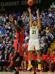 Vermont's Everett Duncan (21) shoots a three pointer during the men's basketball game between the Stony Brook Seawolves and the Vermont Catamounts at Patrick Gym on Saturday afternoon January 13, 2018 in Burlington.
