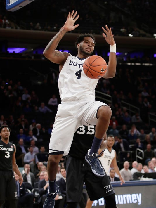 Butler's Tyler Wideman (4) dunks the ball in front of Xavier's RaShid Gaston (35) during the first half of an NCAA college basketball game during the Big East men's tournament Thursday, March 9, 2017, in New York. (AP Photo/Frank Franklin II)