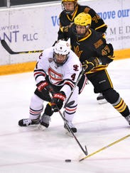 St. Cloud State's Ben Storm controls the puck near