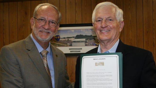 Ridgeland Mayor Gene McGee, left, presents volunteer Jerry Williams with a proclamation Tuesday.