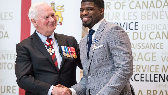P.K. Subban shakes hands with Gov. Gen. David Johnston of Canada after receiving the Meritorious Service Decoration.