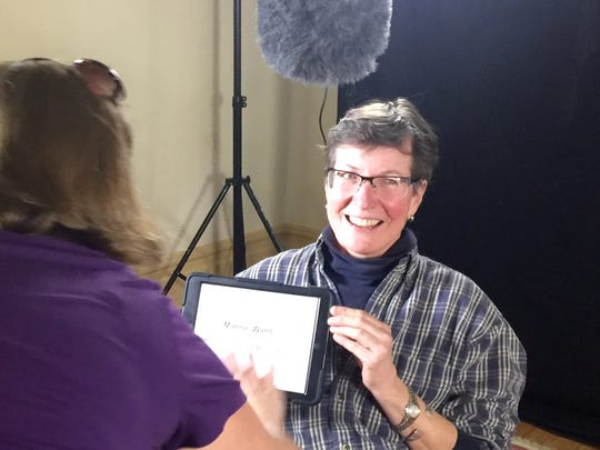 Maron Ward prepares to make a video talking about her connection to Staunton during Staunton Stories on Saturday.  An exhibit of the information and photos gathered during the event will be from 10 a.m. to 2 p.m. from June 18 to July 31, at The Artisan Loft.