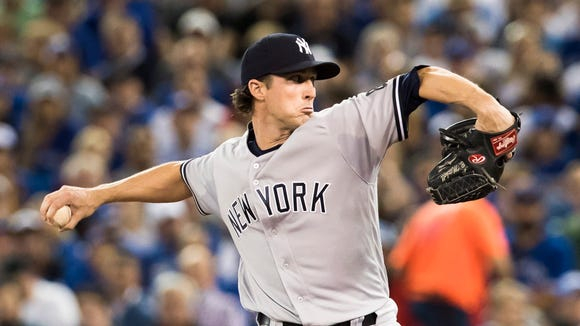 New York Yankees starting pitcher Bryan Mitchell pitches to the Toronto Blue Jays during the first inning of a baseball game in Toronto, Friday, Sept. 23, 2016.