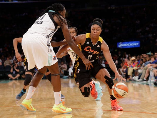 Tulsa Shock guard Odyssey Sims (0) drives past New York Liberty center Tina Charles (31) during the second half of WNBA basketball game, Saturday, Aug. 15, 2015 at Madison Square Garden in New York. .(AP Photo/Mary Altaffer)