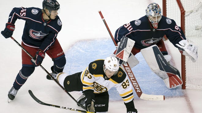 Goaltender Elvis Merzlikins gets ready to make a save during the Blue Jackets' 4-1 win over the Bruins in an exhibition game Thursday. After allowing a goal on the first shot he faced, Merzlikins saved the remaining 12.