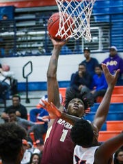 Riverdale's Raquan Rogers goes for a layup during Saturday's