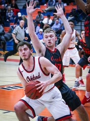Oakland's Cooper Baughn is guarded by Stewarts Creek's Jonathan Pealleaux during Saturday's 7-AAA semifinals.