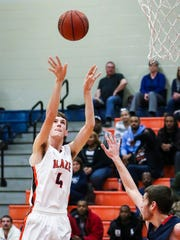 Blackman's Nathan Nelson fires a short jumper during