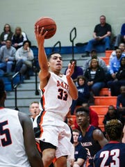Blackman's Trent Gibson goes in for a layup during Saturday's win over Franklin County.
