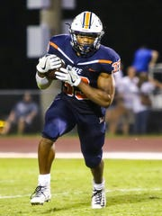 Blackman senior running back Master Teague looks for running room during Friday's 63-28 win over Hendersonville.
