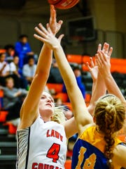 MTCS' Kayla Taylor goes up for a shot during Tuesday's game against BGA.