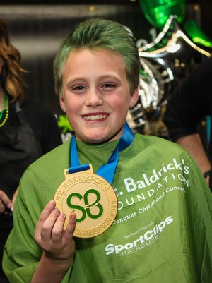 Before braving the shave, Tatum Marks was recognized for being the top money collector at $2,250
