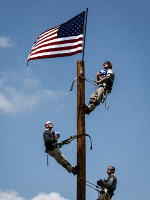Flag raising at opening ceremonies at the 21st annual Tennessee Valley Lineman Rodeo on Saturday in Murfreesboro.