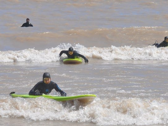 Shorewood High School students learned how to surf